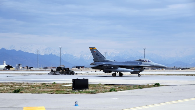 An F-16 Fighting Falcon is caught by the Mobile Aircraft Arresting System during a test of its operational functionality March 20, 2015 at Bagram Air Field, Afghanistan. The MAAS was from a separate taxiway as part of the construction of an alternate runway at Bagram. (U.S. Air Force photo by Master Sgt. James Law/released)
