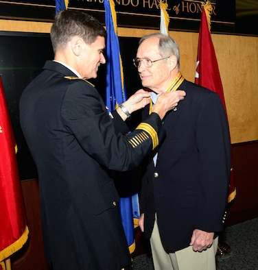 Retired Air Force Maj. Gen. James L. Hobson, Jr. receives the USSOCOM Commando Hall of Honor Medal from Army Gen. Joseph Votel, commander of USSOCOM, April 6, 2015 at the headquarters, MacDill Air Force Base, Fla. The command and special operations community gathered to honor nine individuals whose service spanned 70 years from World War II to Operation Enduring Freedom. The nine inductees for 2015 were Air Force Maj. Gen. (ret.) James L. Hobson, Jr., Army 1st Lt. Jack L. Knight, Air Force Col. (ret.) James Kyle, Command Sgt. Maj. (ret.) Richard Lamb, Marine Corps Lt. Col. (ret.) Terrence L. Moore, Marine Corps (ret.) John W. Ripley, Army Col. (ret.) Phillip R. Stewart, Army Col. (ret.) Lynn B. Stull, and Chief Warrant Officer Four (ret.) Paul A. Zeisman. Photo by Mike Bottoms, USSOCOM Public Affairs.