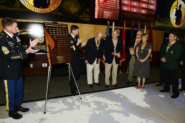 The Commando Hall of Honor plaque is unveiled at a ceremony honoring nine new U.S. Special Operations Command Hall of Honor inductees April 6, 2015, at the headquarters, MacDill Air Force Base Fla. The command and special operations community gathered to honor the nine former special operators whose service spanned 70 years from World War II to Operation Enduring Freedom.  (Photo by Mike Bottoms, USSOCOM Public Affairs)