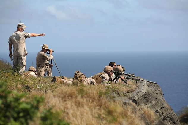 Marine scout snipers with Weapons Company, 2nd Battalion, 3rd Marine Regiment, conduct high angle shooting on top of Ulupau Crater at Range 10 aboard Marine Corps Base Hawaii, April 8, 2015. The training was different from their typical flat-level or slight elevation ranges. The high angle is considered anything 30 degrees or greater.