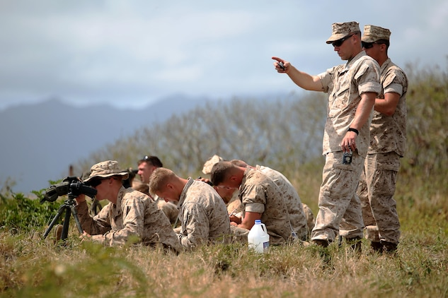 Marines with scout sniper platoon with Weapons Company, 2nd Battalion, 3rd Marine Regiment, calculate shots on top of Ulupau Crater at Range 10 aboard Marine Corps Base Hawaii, April 8, 2015. The training was instructed by noncommissioned officers in the platoon, with senior leadership supervision.