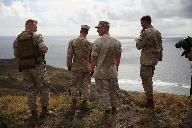 Marines with scout sniper platoon, Weapons Company, 2nd Battalion, 3rd Marine Regiment, rest at the top of Ulupau Crater at Range 10 aboard Marine Corps Base Hawaii after a hike up the crater, April 8, 2015. The Marines trained with high angle shooting, which is anything 30 degrees or greater between them and their target.