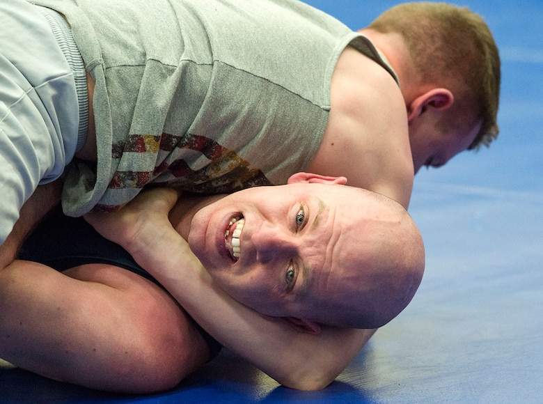 Service members compete in an intramural wrestling tournament on Joint Base Elmendorf-Richardson, Alaska, April 9, 2015. (U.S.Air Force photo/Alejandro Pena)