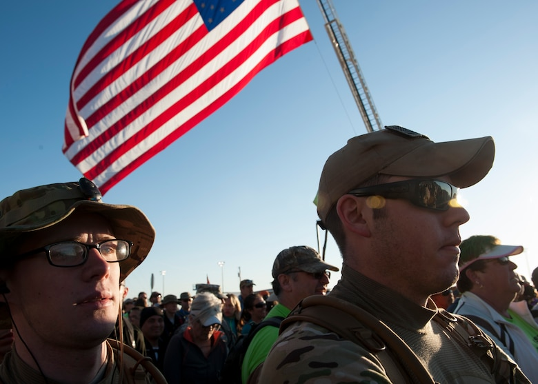 Airman 1st Class Nicholas Maggelet, a 19th Logistics Readiness Squadron aircraft services member, along with Staff Sgt. Christopher Decker, a 19th LRS aerial delivery supervisor, participate in the Bataan Memorial Death March at White Sands Missile Range, N.M. March 22, 2015. The participants were able to meet and speak with World War II survivors of the Bataan Death March before the march. (U.S. Air Force photo by Airman 1st Class Scott Poe)