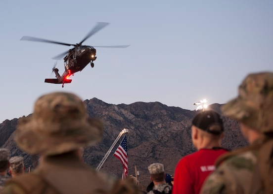 A U.S. Army Blackhawk performs a flyover March 22, 2015, during the opening ceremony of the Bataan Memorial Death March at White Sands Missile Range, N.M. The 26.2-mile march is designed to show participants what the prisoners of war at Bataan endured, even though the POWs actually marched more than 60 miles without food or water, many were beaten, and some never made it to the end. (U.S. Air Force photo by Airman 1st Class Scott Poe)