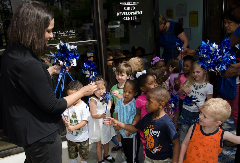 Brenda Edmond, 628th Medical Group Family Advocacy Outreach Program manager, hands out pinwheels to children April 8, 2015 at the Karen Scott Heath Child Development Center on Joint Base Charleston – Weapons Station, S.C. The pinwheels are a symbol for child abuse prevention and intended to be an uplifting reminder of childhood and the bright future children deserve. (U.S. Air Force photo/Staff Sgt. AJ Hyatt)