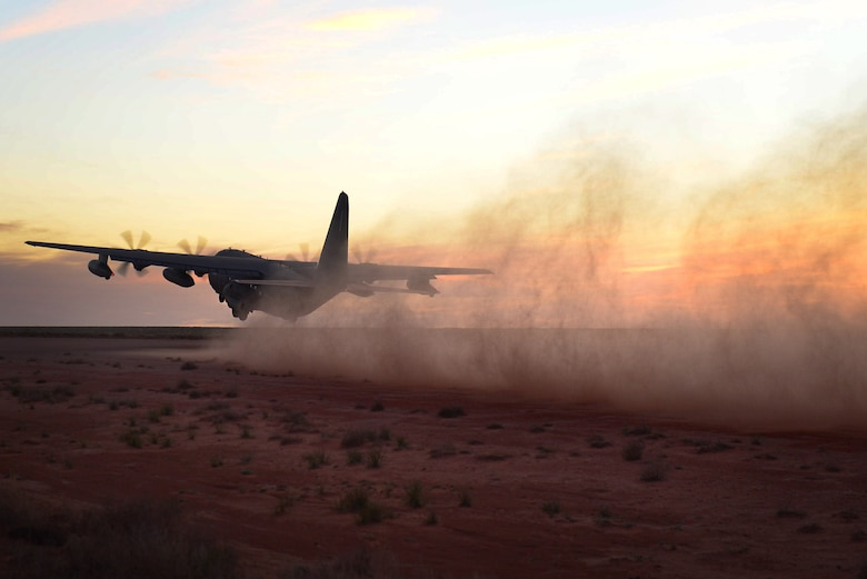 Leaving a trail of dust in its wake, an MC-130J Commando II takes off April 2, 2015, at Melrose Air Force Range, N.M. The aircraft's crew demonstrated its capability to take off, land and perform airdrops in remote areas during a joint exercise. (U.S. Air Force photo/Airman 1st Class Shelby Kay-Fantozzi)