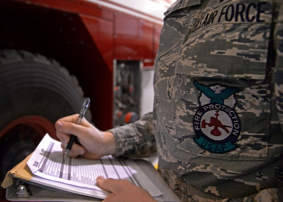 U.S. Air Force Airman 1st Class Tyler Foster, 27th Special Operations Civil Engineer Squadron firefighter, annotates morning inspections on a checklist April 8, 2015 at Cannon Air Force Base, N.M. Cannon's fire protection crew conducts daily function checks of all operable equipment following morning roll call. (U.S. Air Force photo/Staff Sgt. Alex Mercer)