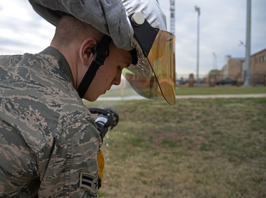 U.S. Air Force Airman 1st Class Tyler Foster, 27th Special Operations Civil Engineer Squadron firefighter, tests hose operability April 8, 2015 at Cannon Air Force Base, N.M. Cannon's fire protection crew conducts daily ops checks of all essential equipment following morning roll call. (U.S. Air Force photo/Staff Sgt. Alex Mercer)