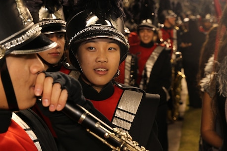 Melissa Chan, Clarinet Section Leader, Colony High School Marching Band, speaks with fellow musician before winning the Battle of the Bands at the 2015 Semper Fidelis All-American Bowl. The bowl honors players who demonstrate the Marine Corps' commitment to developing quality citizens and reinforces core values of honor, courage and commitment on and off the field.