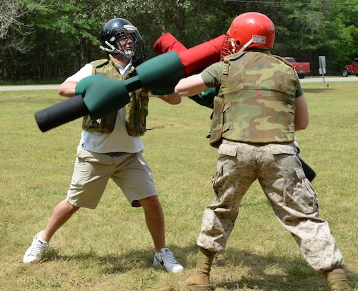 Eddie Zedaker with TTL Inc. tests his abilities against a Marine opponent during pugil stick training. He was part of the Leadership Albany Class of 2015, who participated in daylong activities aboard Marine Corps Logistics Base Albany, April 9. Representing various local businesses in Albany, the group learned about MCLB Albany and its tenant commands' missions and roles in the Marine Corps.