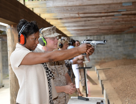 Benita Childs with the Albany Police Department fires a 9 mm at Marine Corps Logistics Base Albany's Pistol Range. She was part of the Leadership Albany Class of 2015, who participated in daylong activities aboard Marine Corps Logistics Base Albany, April 9. Representing various local businesses in Albany, the group learned about MCLB Albany and its tenant commands' missions and roles in the Marine Corps.