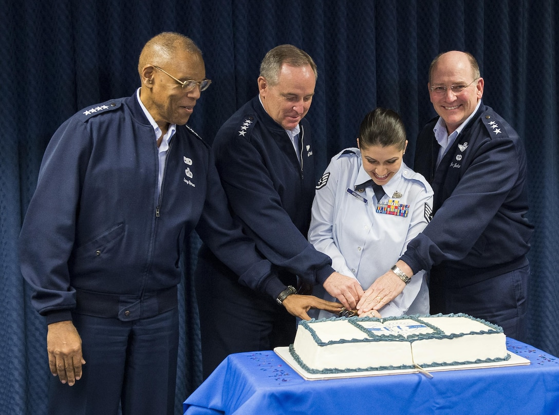 "Air Force Chief of Staff Gen. Mark A. Welsh III (second from left), the junior most ranking member in the Office of the Air Force Reserve (RE), Staff Sgt. Ivanka Vrechkov (third from left), Vice Chief of Staff Gen. Larry Spencer (left) and Chief of the Air Force Reserve Lt. Gen. James ""JJ"" Jackson (right) cut a cake celebrating the Air Force Reserve's 67th birthday during a ceremony in the Pentagon, April 6, 2015, Washington, D.C. Vrechkov is the Non-Commissioned Officer in Charge of Policy Integration for RE. The Air Force Reserve was established on April 14, 1948 by President Harry S. Truman, seven months after the active duty Air Force was established as a separate service. Originally the Air Force Reserve was a standby force for use in wartime and national emergencies. The Air Force Reserve has worked closely with their active duty counterparts since the first associate unit stood up at Norton Air Force Base, Calif. in 1968. The Air Force Reserve also performs unique missions such as aerial fire fighting, aerial spray and weather reconnaissance. (U.S. Air Force photo/Jim Varhegyi)"