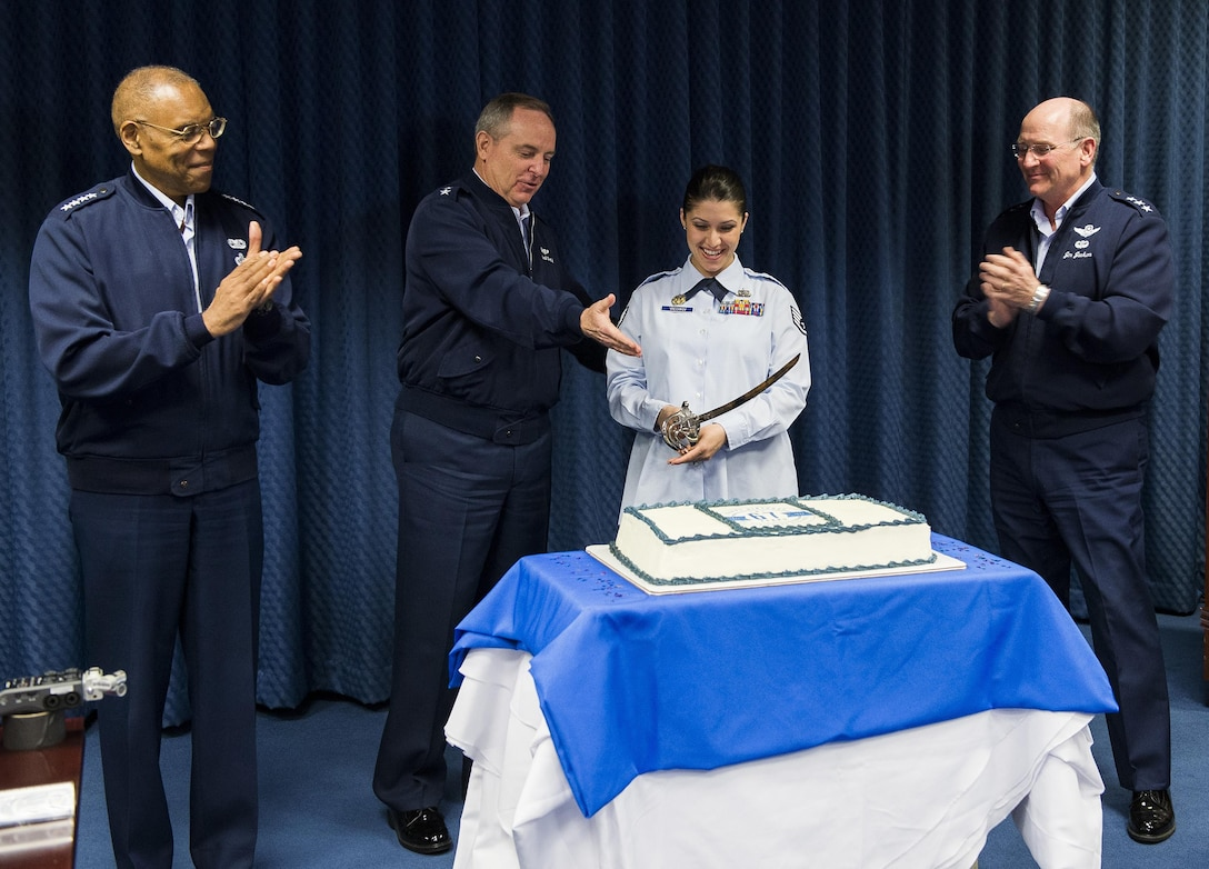 Air Force Chief of Staff Gen. Mark A. Welsh III (second from left) invites the junior most ranking member of Reserve Affairs (RA) staff, Staff Sgt. Ivanka Vrechkov (third from left) to cut a cake celebrating the Air Force Reserves 67th birthday during a ceremony in the Pentagon, April 6, 2015, Washington, D.C. Also on hand for the ceremony were Vice Chief of Staff Gen. Larry Spencer (left) and Chief of the Air Force Reserves Lt. Gen. James Jackson (right).  Vrechkov is the Non-Commissioned Officer in Charge of Policy Integration for RA. The reserves were established on April 14, 1948 by President Harry S. Truman, seven months after the active duty Air Force was established as a separate service. Originally the reserves were a standby force for use in wartime and national emergencies. The Air Force Reserves became a Major Command (MAJCOM) in 1973 and began working side-by-side with their active duty counterparts. The reserves also perform unique missions such as pararescue and weather reconnaissance. (U.S.Air Force photo/Jim Varhegyi)