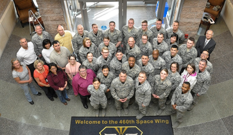 Chief Master Sgt. Douglas McIntyre, Air Force Space Command command chief, poses for a group photo with 460th Space Wing Airmen during his base visit April 9, 2015, on Buckley Air Force Base, Colo. During his visit, McIntyre spoke on Buckley AFB's vast mission, its importance to national security, and the Airmen who accomplish the mission every day. (U.S. Air Force photo by Tech. Sgt. Nicholas Rau/Released)