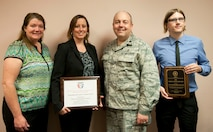 (Left to right) Tracy Bogdanovich, 99th Medical Operations Squadron clinical research coordinator, Jill Clark, 99th MDOS clinical research manager, Lt. Col. Paul Crawford, 99th MDOS Clinical Investigation Program and Family Medicine Residency program director, and Aaron Barnett, 99th MDOS clinical research coordinator, pose for a photo at the Mike O'Callaghan Federal Medical Center on Nellis Air Force Base, Nev., April 6, 2015. The CIP was presented with the Association of Military Surgeons of the United States 2014 Training and Education Award and the FMR was presented with the 2015 Outstanding Achievement in Scholarly Activity Award by the Uniformed Services Academy of Family Physicians. (U.S. Air Force photo by Airman 1st Class Mikaley Towle)