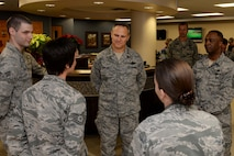 Lt. Gen. Chris Nowland, 12th Air Force commander, speaks with Airmen from the 28th Medical Operation Squadron Family Health Clinic during his visit at Ellsworth Air Force Base, S.D., April 8. 2015. Nowland toured the facility and congratulated Airmen on their contributions toward winning the 2014 Air Force Medical Service Outstanding Patient Center Medical Home award. (U.S. Air Force photo by Airman 1st Class Rebecca Imwalle/Released)