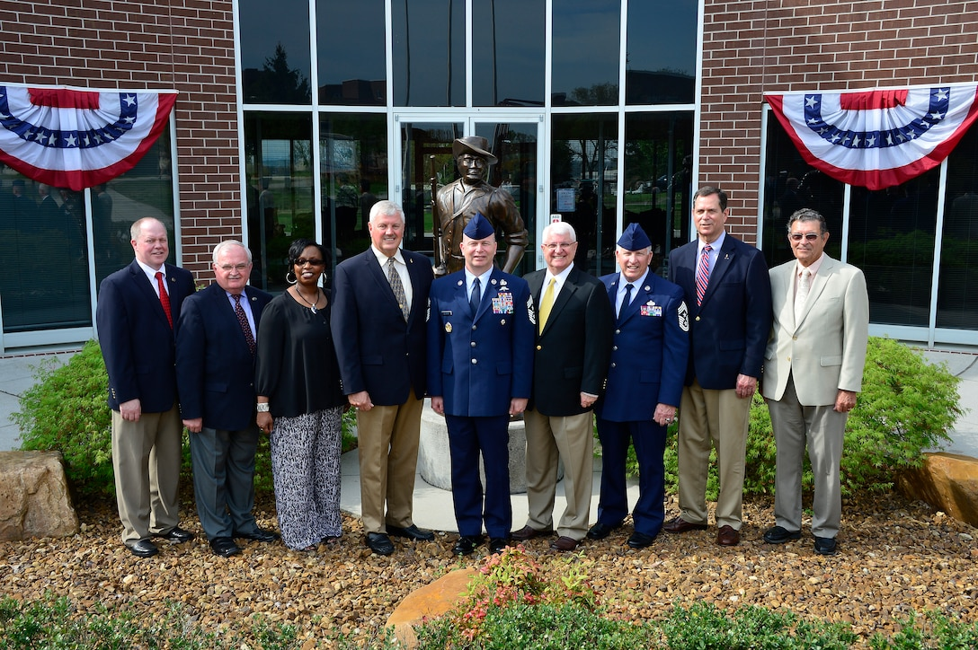 MCGHEE TYSON AIR NATIONAL GUARD BASE, Tenn. - The Air National Guard's current and former top enlisted leaders stand outside Patriot Hall here, April 9, 2015, at the I.G. Brown Training and Education Center, from left, retired Chief Master Sgt. Christopher Muncy (2009-2012), retired Chief Master Sgt. Richard Smith (2004-2009), retired Chief Maser Sgt. Valerie Benton (2001-2004), retired Chief Master Sgt. Gary Broadbent (1998-2001), Chief Master Sgt. James Hotaling (current), retired Chief Master Sgt. Edwin Brown (1994-1998), retired Chief Master Sgt. Richard Moon (1990-1994), retired Chief Master Sgt. Richard Green (1986-1990), retired Chief Master Sgt. Lynn Alexander (1977-1983). The chief's attended a ceremony naming Moon Hall as well as a graduation ceremony for NCO academy and Airman leadership school, among other events. (U.S. Air National Guard photo by Master Sgt. Jerry Harlan/Released)