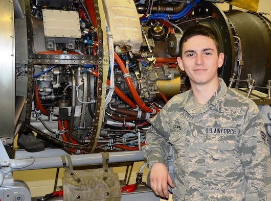 Airman 1st Class Michael Gemma, 175th Maintenance Squadron aircraft engine mechanic, stands in front of a T-34 engine at Warfield Air National Guard Base in Baltimore, Md. Gemma is the 175th Wing April Airman Spotlight. (U.S. Air National Guard photo by Tech. Sgt. David Speicher/RELEASED)