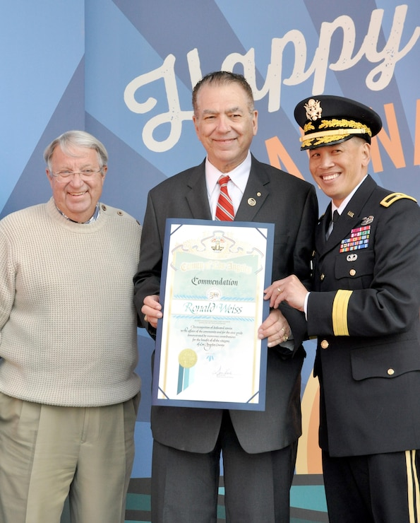 Brig. Gen. Mark Toy, Commanding General of the USACE South Pacific Division and Don Knabe, Los Angeles County Supervisor, presented a scroll to Ron Weiss, a former USACE employees who worked on the marina since its beginning in the 1950s. USACE workers were recognized at Marina del Rey's 50th Birthday Bash for the design and work efforts in taking and keeping Marina del Rey from the duck hunting marsh it was into the Marina it is today.