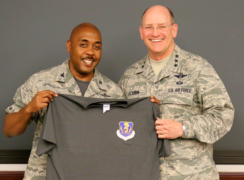 Col. Lloyd Terry, 960th Cyberspace Operations Group commander, presented Lieutenant General James F. Jackson, Air Force Reserve Command commander, a 960 CyOG unit morale t-shirt during his visit April 10 to the unit at Joint Base San Antonio-Lackland, Texas. The 960 CyOG is the first cyberspace group in the Air Force and has administrative control over 10 Reserve cyber units throughout the country. Its mission is to train and equip Citizen Airmen to extend, operate, defend and engage to fight and win... in, from and through Cyberspace. (U.S. Air Force photo/Master Sgt. Josh Woods)