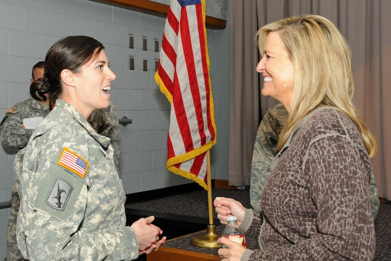 Army Sgt. Mercedes Millward, Sisters-In-Arms advisory board member, thanks Sharlene Wells Hawkes for setting an example for female leaders by sharing her personal stories and message. Hawkes was the keynote speaker during the Utah Sisters-In-Arms program kickoff event April 1, 2015. (Air National Guard photo by Capt. Jennifer Eaton/RELEASED)