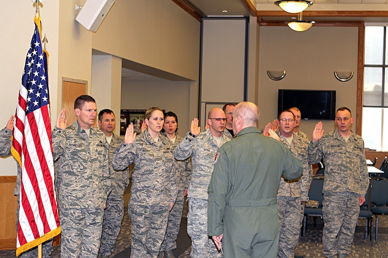 150411-Z-VA676-220 -- A group of Michigan Air National Guard Airmen take the oath of enlistment during a ceremony at Selfridge Air National Guard Base, Mich., April 11, 2015. Thirty Michigan ANG Airmen re-enlisted for three years or more during the first quarter of fiscal year 2015. Several dozen more have extended their existing enlistment or re-enlisted for shorter periods. Administering the oath is Brig. Gen. John D. Slocum, 127th Wing commander. (U.S. Air National Guard photo by Tech. Sgt. Dan Heaton)