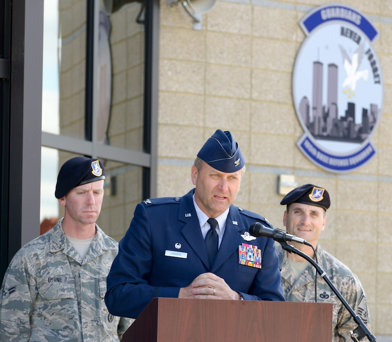 "U.S. Air Force Col Timothy J. LaBarge, commander of the 105th Airlift Wing, New York Air National Guard, addresses guests, media and members of the military community of Stewart Air National Guard base at a ribbon cutting event to officially open the Wing's Base Defense Squadron Headquarters building. The opening was held shortly after the posthumous award of the Bronze Star Medal with Valor to SSgt. Todd ""T.J."" Lobraico on April 11, 2015. Lobraico Jr., a member of the 105th Airlift Wing, was killed in action in Afghanistan on Sept. 5, 2013, (U.S. Air National Guard photo by SSgt Michael OHalloran/Released)"