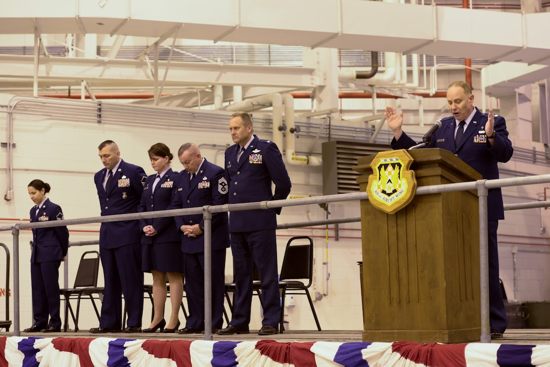 """105th Airlift Wing Chaplain, Lt Col Robert Tilli gives the opening prayer at a ceremony recognizing New York Air National Guard Staff Sgt. Todd """"T.J."""" Lobraico, a member of the 105AW who was killed in action in Afghanistan in Sept. 5, 2013. Lt Col Linda Rohatsch and Master Sgt. Todd Lobriaco, """"T.J.""""s parents both ot whom are members of the 105AW, accepted the posthumous award of the Bronze Star Medal with Valor, on his behalf at a ceremony presided over by Col Timothy J. LaBarge, commander 105AW at Stewart Air National Guard Base on Saturday, April 11, 2015.(U.S. Air National Guard Photo by SSgt Michael OHalloran/Released)"""