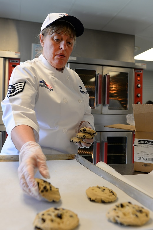 Staff Sgt. Jacqueline Bergeron, 157th Force Support Squadron Services Flight technician, places cookies on a cooking sheet during the April Unit Training Assembly in the kitchen of the Aerospace Dining Facility April 11. The 157 FSS team has been selected as one of the top three Air National Guard food services operations in the nation. Entering its 15th year, the Senior Master Sergeant Kenneth  Disney Award has been established to improve food service throughout the Air National Guard, increase morale, encourage competition, recognize excellence and honor the late Disney. Disney was the services superintendent at McGee Tyson Air Base, Tenn., for more than 20-years where he earned a reputation for commitment to providing outstanding food service. (N.H. Air National Guard photo by Senior Airman Kayla McWalter)