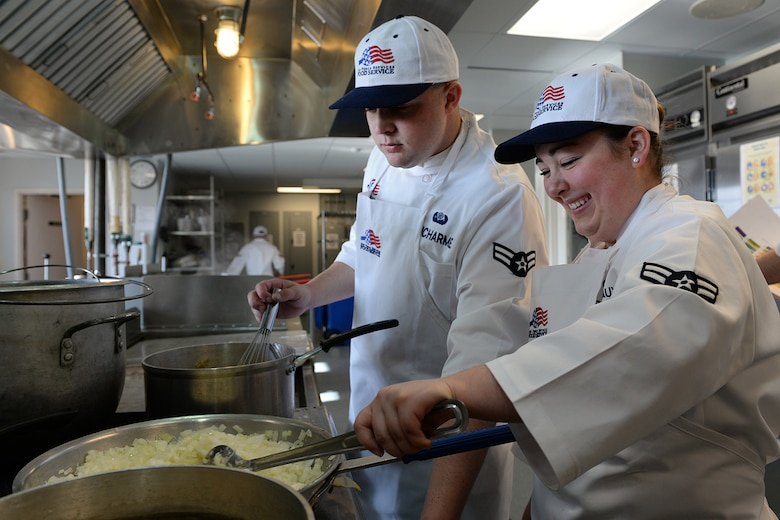 Airman 1st Class Ryan Ducharme and Airman 1st Class Jordyn Descoteaux, members of the 157th Force Support Squadron Services Flight, prepare lunch during the April Unit Training Assembly in the kitchen of the Aerospace Dining Facility April 11. The 157 FSS team has been selected as one of the top three Air National Guard food services operations in the nation. Entering its 15th year, the Senior Master Sergeant Kenneth  Disney Award has been established to improve food service throughout the Air National Guard, increase morale, encourage competition, recognize excellence and honor the late Disney. Disney was the services superintendent at McGee Tyson Air Base, Tenn., for more than 20-years where he earned a reputation for commitment to providing outstanding food service. (N.H. Air National Guard photo by Senior Airman Kayla McWalter)