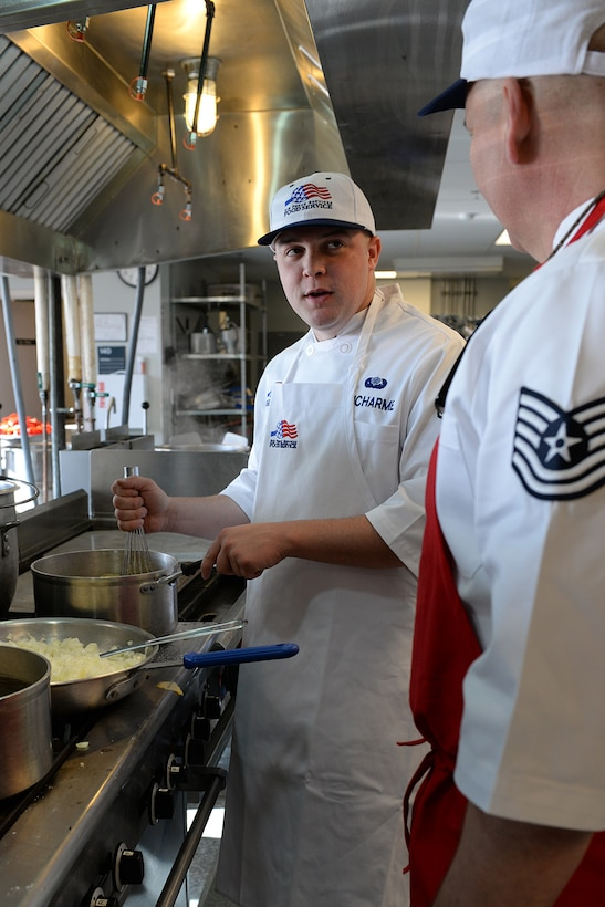 Airman 1st Class Ryan Ducharme, 157th Force Support Squadron Services Flight technician, prepares lunch for members of the N.H. Air National Guarrd during the April Unit Training Assembly in the kitchen of the Aerospace Dining Facility April 11. The 157 FSS team has been selected as one of the top three Air National Guard food services operations in the nation. Entering its 15th year, the Senior Master Sergeant Kenneth  Disney Award has been established to improve food service throughout the Air National Guard, increase morale, encourage competition, recognize excellence and honor the late Disney. Disney was the services superintendent at McGee Tyson Air Base, Tenn., for more than 20-years where he earned a reputation for commitment to providing outstanding food service. (N.H. Air National Guard photo by Senior Airman Kayla McWalter)