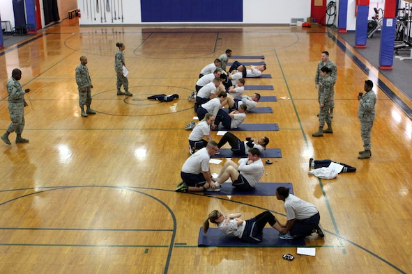 150412-Z-VA676-022 -- Airmen of the 127th Wing conduct sit-ups in a newly-refurbished gymnasium building at Selfridge Air National Guard Base, Mich., April 12, 2015. The gym building, constructed in the early 1930s, was recently refurbished for use as a fitness center after temporarily providing office space for one of the base's flying squadrons. (U.S. Air National Guard photo by Tech. Sgt. Dan Heaton)