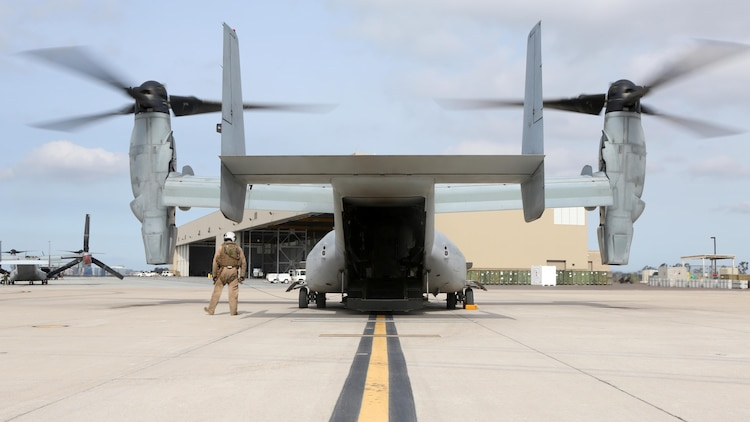 Marines with Marine Medium Tiltrotor Squadron 163 perform pre-flight checks on MV-22B Ospreys prior to a large-scale training flight aboard Marine Corps Air Station Miramar, California, April 10. This training operation marks the last time the commanding officer of VMM-163 will participate in a squadron-sized event before relinquishing command.
