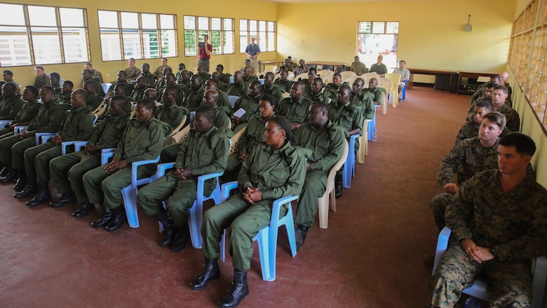 Marines and Sailors assigned to a Security Cooperation Team with Special-Purpose Marine Air-Ground Task Force Crisis Response-Africa, and Tanzanian park rangers attend a graduation ceremony on the Selous Game Reserve in Matambwe, Tanzania, March 27, 2015. More than 40 park rangers graduated from counter illicit-trafficking training, which was the first-ever engagement between U.S. Marines and Tanzanian park rangers. The Marines and Sailors taught the park rangers infantry skills such as weapons handling, land navigation, and patrolling in an attempt to help combat illicit-trafficking.