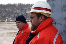 John Dilla, (right), chief, Locks and Dams Branch, and Mark Ivanisin, Ohio River operations supervisor, observe barge recovery operations.