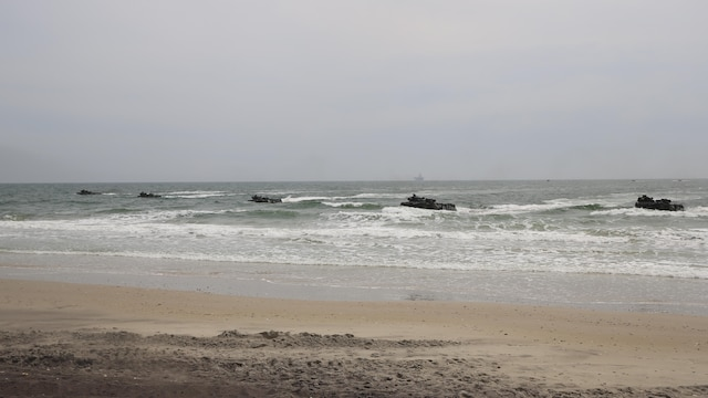 Amphibious Assault Vehicles with 2nd Assault Amphibian Battalion, 2nd Marine Division, approach Onslow Beach, Camp Lejeune, N.C., during an amphibious assault and movement to contact training, April 9, 2015. Each of the vehicles carried Marines with 2nd Battalion, 2nd Marine Regiment and after landing they transported the Marines to a range where the movement to contact portion of the training was to be conducted.