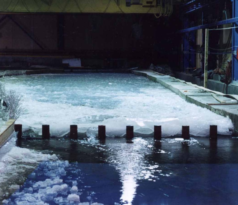 The Research Area in CRREL's Ice Engineering Facility is an 80-foot by 160-foot refrigerated room with a variety of equipment, a water reservoir and water flow capabilities, and environmental controls to conduct large, realistic physical model studies of lakes, rivers and other terrain.