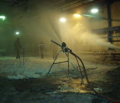 In a refrigerated room at the ERDC Cold Regions Research and Engineering Laboratory's Ice Engineering Facility, Snow Logic, a developer of snowmaking technologies recently compared snow guns for performance.