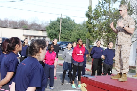 Maj. John F. Campbell, commanding officer of Marine Corps Recruiting Station New Jersey, explains the importance of the 2015 Annual Female Pool Function to more than fifty poolees at Naval Weapons Station Earle in Colts Neck, N.J., April 11, 2015.