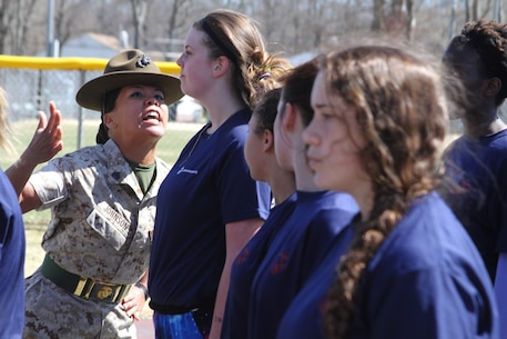 "Sgt. Stephanie Johnson, drill instructor stationed at Marine Corps Recruit Depot Parris Island, S.C., corrects a female poolee during the ""drill instructor time"" drill at the 2015 Annual Female Pool Function at Naval Weapons Station Earle in Colts Neck, N.J., April 11, 2015."