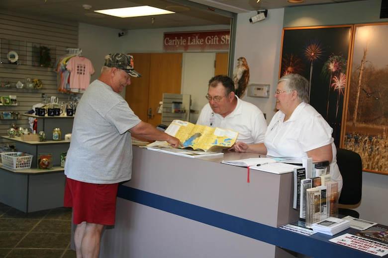 Volunteers at Carlyle Lake assisting a visitor at the Carlyle Lake visitor center.