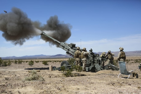 Marines with 1st Battalion, 11th Marine Regiment, 1st Marine Division, fire an M777 howitzer during Exercise Desert Scimitar 2015 aboard Marine Corps Air Ground Combat Center Twentynine Palms, Calif., April 7, 2015. The tough, realistic live-fire training central to Desert Scimitar allows Division units to train in order to maintain readiness and meet current and real-world operational demands.