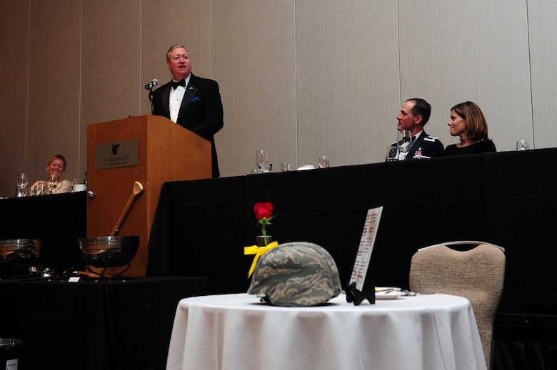 Michael B. Donley, retired Secretary of the Air Force, speaks to Airmen of the 563rd Rescue Group during a dining-in event at the JW Marriott Resort in Tucson, Ariz., April 11, 2015. During his address, Donley shared some of the lessons he learned as acting SAF, and emphasized that the success of the Air Force's mission is directly dependent on the performance of its Airmen. (U.S. Air Force photo by Airman 1st Class Chris Drzazgowski/Released)