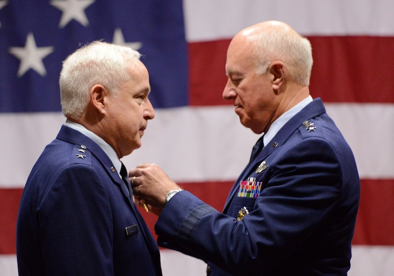 """Maj. Gen William S. Hadaway III, former Director of Logistics, National Guard Bureau, receives """"The Distinguished Service Medal"""" from former Director of the Air National Guard Lt. Gen. Harry M. Wyatt III (ret.), April 11, at the Brig. Gen. Joseph W. Turner complex, Tulsa Air National Guard Base, Okla.  Both Wyatt and Hadaway were former wing commanders at the 138th Fighter Wing in Tulsa.  (U.S. National Guard photo by Master Sgt. Mark A. Moore/Released"""
