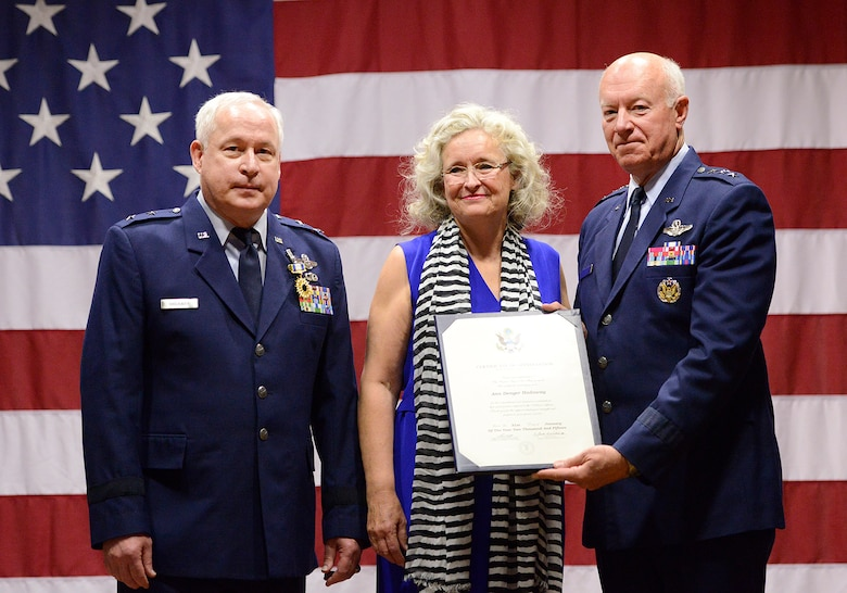 Mrs. Ann Hadaway receives a certificate of appreciation from former Director of the Air National Guard Lt. Gen. Harry M. Wyatt III (ret.) for her years of support for her husband, Maj. Gen William S. Hadaway III, former Director of Logistics, National Guard Bureau, during his retirement ceremony, April 11, at the Brig. Gen. Joseph W. Turner complex, Tulsa Air National Guard Base, Okla.  Both Wyatt and Hadaway were former wing commanders at the 138th Fighter Wing in Tulsa.  (U.S. National Guard photo by Master Sgt. Mark A. Moore/Released)