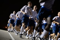 "United States Air Force basic trainees from the 323rd Training Squadron run in formation during morning physical training at Joint Base San Antonio-Lackland, Texas, April 8, 2015. Known as the ""Gateway to the Air Force,"" all enlisted Airmen complete basic military training at Lackland, where more than 30,000 new Airmen graduate every year. (U.S. Air Force photo/Tech. Sgt. Trevor Tiernan)"