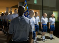 "A United States Air Force Military Training Instructor from the 323rd Training Squadron forms up his flight prior to marching them out for morning physical training at Joint Base San Antonio-Lackland, Texas, April 8, 2015. Known as the ""Gateway to the Air Force,"" all enlisted Airmen complete basic military training at Lackland, where more than 30,000 new Airmen graduate every year. (U.S. Air Force photo/Tech. Sgt. Trevor Tiernan)"