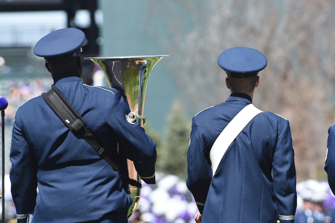 Members from the U.S. Air Force Academy Band Stellar Brass wait to perform the Star Spangled Banner during the Colorado Rockies Opening Day ceremony April 10, 2015, at Coors Field in Denver. Service members from all branches of service and Colorado law enforcement participated in the opening day festivities, to include an F-16 Fighting Falcon aircraft flyover and the unfurling of the American flag on the outfield. (U.S. Air Force photo by Airman 1st Class Samantha Saulsbury/Released)
