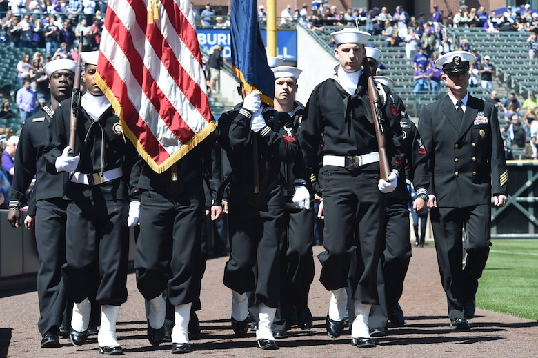 U.S. Navy Color Guard members present the colors during the Colorado Rockies Opening Day ceremony April 10, 2015, at Coors Field in Denver. Service members from all branches and Colorado law enforcement participated in the opening day festivities, to include an F-16 Fighting Falcon aircraft flyover and unfurling the American flag on the outfield. (U.S. Air Force photo by Airman 1st Class Samantha Saulsbury/Released)